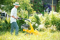 Man mowing the lawn with a lawn_mower