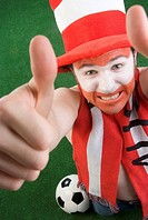 optimistic Austrian soccer fan makes thumbs up
