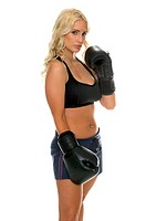 healthy young woman with black boxing gloves