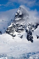 snow covered mountain in the clouds, Antarctica, Antarctic peninsula, Paradise Bay