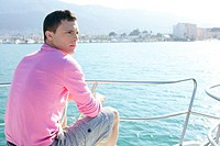 Handsome young man on boat, blue summer vacation outdoor