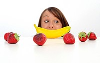 woman with banana and strawberries
