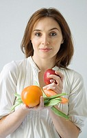 Red-haired woman holding vegetables