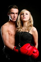 Sexy young male boxer with blond beautiful girl, isolated on black studio shot