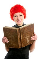 Happy funny student beautiful girl with orange wig and old book