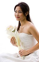 A beautiful young Asian woman in her wedding dress