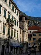 houses and clock tower at the main square in the old town of Kotor, Serbia and Montenegro