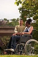 woman in wheelchair with child