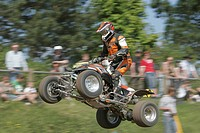 All-terrain vehicle or Quad jumping at a Supermoto race