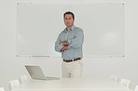 man in front of office whiteboard
