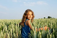 Girl walking in a wheat field
