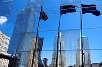 Reflection of Ground Zero and flags on a facade, New York City, USA