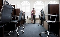 Couple hugging in a empty office