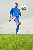 Man kicking soccer ball