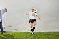 Man and woman playing soccer