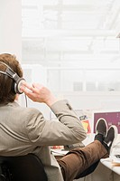 Man listening to music in office
