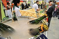 Apple wine bottles in a barrel filled with water and dry-ice, Slow Food Trade Fair, Stuttgart Messe, fairgrounds, Baden-Wuerttemberg, Germany, Europe