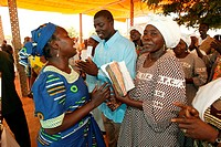 Women in conversation at a church service, Garoua, Cameroon, Africa