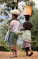 women carry goods in Ngiresi Village, Tanzania, Arusha National Park