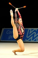 woman doing rhythmic gymnastics with clubs