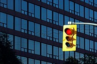 red traffic sign in front of a high_rise building with offices, Canada, Ontario, Toronto