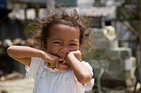 A small girl on Bohol Island, excited because of tourists, Philippines, South East Asia