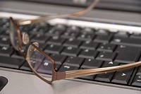 glasses on computer keyboard