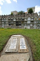 Grave in a family burial plot beneath engraved stone slabs in the cemetery of the Iglesia de Santiago de Cereixo Church in Camarinas, La Coruna, Galic...