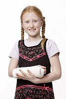 8_year_old girl with her arm in plaster, laughing