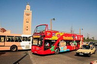 Double-decker open-top tourist bus in front of the Koutoubia Mosque, Marrakech, Morocco, Africa