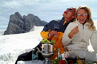 couple drinking wine in the snow, Austria, Alps