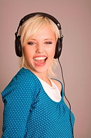 Blond woman with headphones on her head