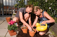 Mother and daughter gardening on a roof garden