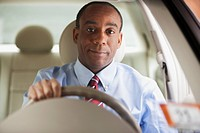 African businessman driving car