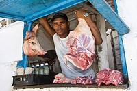 Meat vendor putting up pork for sale, Trinidad, Sancti-Spíritus Province, Cuba, Latin America, America