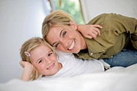 Germany, Ammersee, Diessen, Mother with daughter 6_7 at home, smiling, portrait