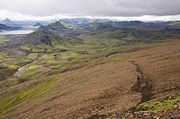 Iceland, Two Men mountain biking in hilly landscape
