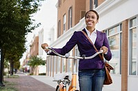 African American woman riding bicycle