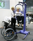 Lift for handicapped persons at Medica 2007, world's biggest trade show for medical equipment and technologies, Duesseldorf, North Rhine-Westphalia, G...