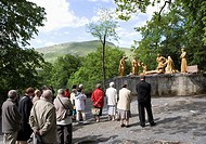 France, Lourdes, Via Crucis, Sculptures, Pilgrims watching
