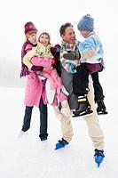 Italy, South Tyrol, Seiseralm, Family on frozen lake