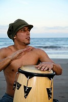 Spain, Canary Islands, Gran Canaria, Young man drumming