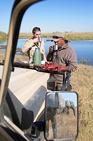 Africa, Botswana, Okavango Delta, Men on safari having a break