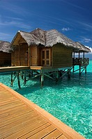 Water bungalows on the tropical island of Fihalhohi in the Maldives