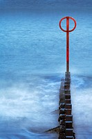 Wave breaker and red marking pole at Aberdeen bay