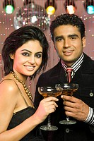 Couple holding wine glasses in a nightclub