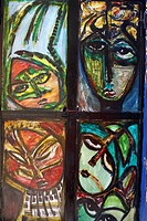Cuban wall paintings of faces peering through window at Havana, Cuba, West Indies, Caribbean, Central America