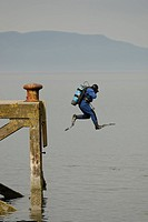 A diver carries out a jump entry from a disused pier at Firth of Clyde, Scotland This method of entering the water is initially exhilarating but becom...