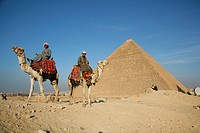 Camel riders in front of pyramid, Giza, Egypt, North Africa, Africa