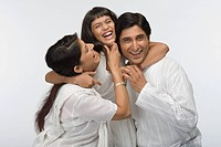 Close_up of parents having fun with their daughter